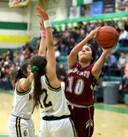 Senior Lady 'Cat Nicole Lopez (10) left it all out on the Mayfield High court Wednesday in Las Cruces. The Deming High guard tossed in 9 points in a 50-32 District 3-5A tournament loss.