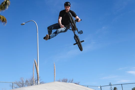 Douglas Laird does trick on his BMX bike at the Las Cruces skatepark in Las Cruces on Thursday, Feb. 27, 2020.
