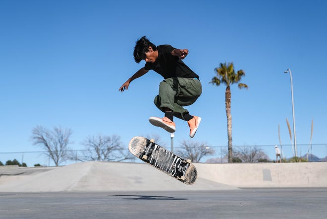 Luis Chavez does a kick flip at the Las Cruces skatepark in Las Cruces on Thursday, Feb. 27, 2020.