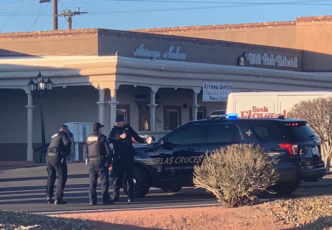 Las Cruces police confer in the Arroyo Plaza, off Lohman Avenue, on Wednesday, Feb. 26, 2020. A driver reportedly fired a gun into the air at the intersection of Lohman and Walton Boulevard.