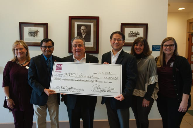 Roy Trujillo presents a scholarship to New Mexico State University in memory of his father. From left to right: Cindy Nicholson, Lakshmi Reddi, Roy Trujillo, Hansuk Sohn, Leslie Cervantes and Sarah Babins.