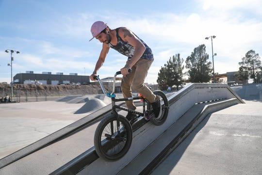 Michael Jimenez rides a rail on his BMX bike at the Las Cruces skatepark in Las Cruces on Thursday, Feb. 27, 2020.
