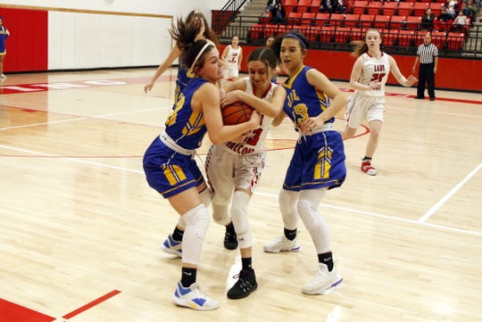 Jal's Halee Edwards fights Loving's Taryn Chacon for a loose ball in the first quarter of Thursday's District 4-2A semifinal game in Loving. The Loving Lady Falcons won, 58-42, and will travel to Eunice on Friday for the championship game.