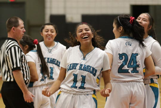 Navajo Prep's Hailey Martin is all smiles after making an and-one 3-pointer against Crownpoint during Wednesday's District 1-3A girls basketball tournament semifinals game at the Eagles Nest in Farmington.