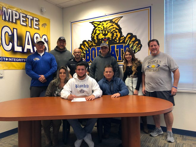Bloomfield quarterback Vince Marquez signs his national letter of intent on Thursday to continue his football career at NAIA's Arizona Christian University.