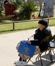 Holy Ghost parishoner Regina Tatum follows the reading of the Holy Bible at Thursday's Jubilee of the Word Marathon.