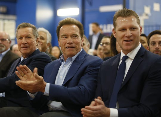 Ohio Gov. John Kasich, from left, former California Gov. Arnold Schwarzenegger and New Way California founder and Assemblyman Chad Mayes attend the first summit for New Way California, a political committee eager to reshape the state's Republican party, in Los Angeles, Calif. on March 21, 2018.