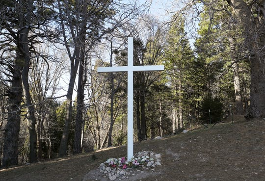 A large cross on the side of Hwy 18 marks the area where the Church of the Woods in Lake Arrowhead plans to build a large campus on this piece of undeveloped forest land in Rimforest, February 26, 2020.