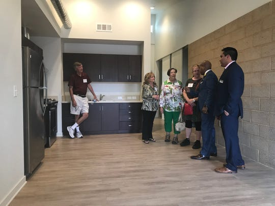 Community members tour a newly built one-bedroom apartment at Washington Street Apartments in La Quinta on February 27, 2020.