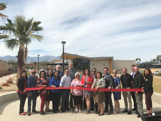 Coachella Valley Housing Coalition officials and representatives from the city of La Quinta at the ribbon-cutting for Washington Street Apartments on February 27, 2020.