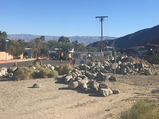 Construction crews work on building a parking lot on Calle Tecate in La Quinta. It replaces street parking near trailheads in the La Quinta Cove neighborhood.
