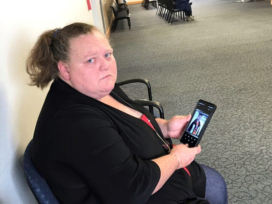 Angela Green sits outside an Escambia County courtroom on Wednesday after a bond hearing for the woman accused of killing her son.