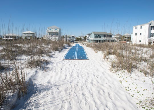 A Mobi-Mat is deployed at walkover number 24B along Pensacola Beach on Thursday, Feb. 27, 2020.  However, the mat stops short of the end of the protected dune line.