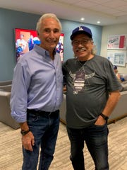 Actor Edward James Olmos, right, poses for a photo with hall of fame baseball pitcher Sandy Koufax.