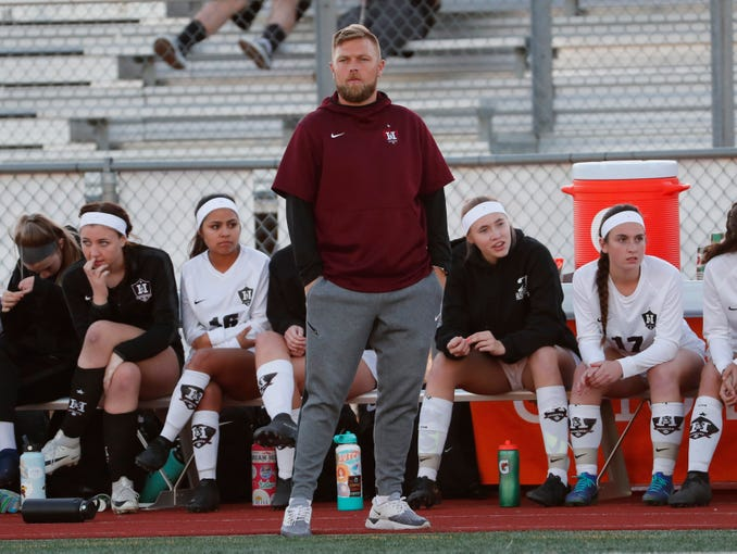 Hamilton head coach Eddie Hertsenberg watches his team play against Chaparral during the Class 6A girls state soccer championship game Feb. 26, 2020.