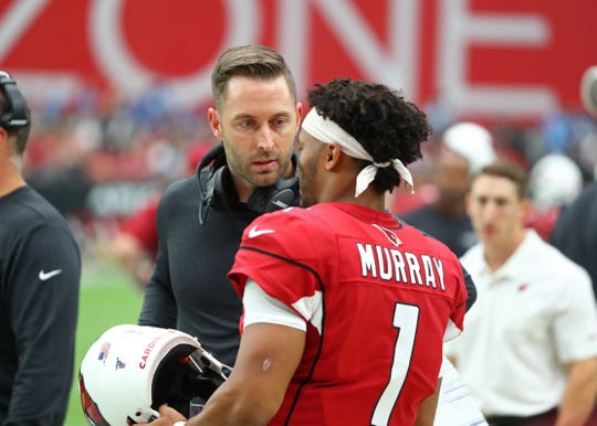 Arizona Cardinals quarterback Kyler Murray (1) talks with head coach Kliff Kingsbury against the Detroit Lions in the second quarter at State Farm Stadium in their first game with the team.
