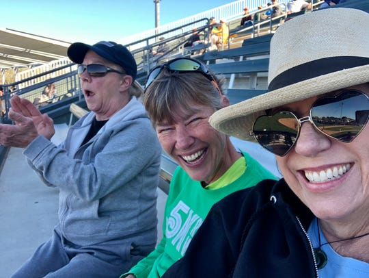 Cousin Janet actually watching the game while cousin Theresa and I pose for a selfie.