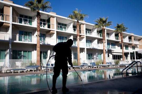 Carlos Hernandez power washes the pool deck at Mountain Shadows Resort in Paradise Valley on Feb. 13, 2020.