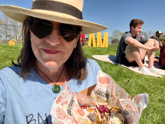 Spring training feels distinctly Arizona, which also explains why I'm holding two tacos and a cheese quesadilla instead of a hot dog.