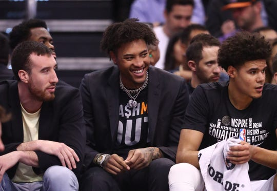 Feb 26, 2020; Phoenix, Arizona, USA; Phoenix Suns injured forward Kelly Oubre Jr. (center) sits on the bench with center Frank Kaminsky (left) and Cameron Johnson against the Los Angeles Clippers in the first half at Talking Stick Resort Arena. Mandatory Credit: Mark J. Rebilas-USA TODAY Sports