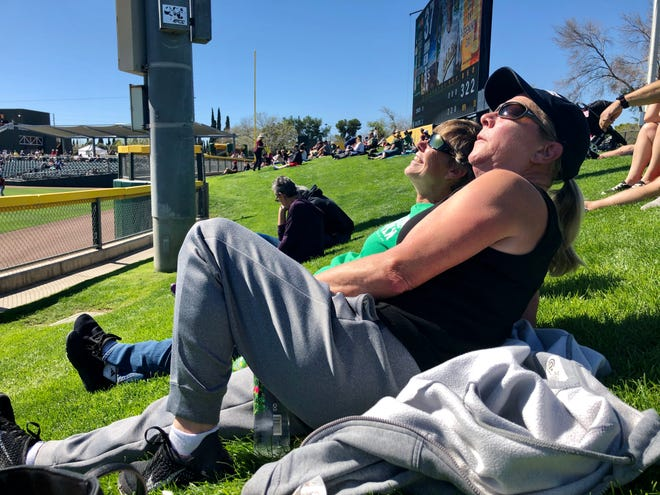 At a spring training game, my cousin Theresa and her wife Janet soak up the sun. They moved here recently from Washington state.