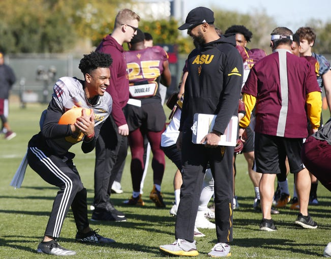 ASU quarterback Jayden Daniels, (5) has a laugh during spring football practice at Kajikawa Practice Facility in Tempe on February 27, 2020.
