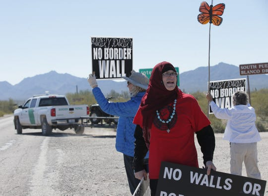 Sumayyah Dawud, of Phoenix, and Susan Waites, of Tucson, protest the construction of the border wall at Organ Pipe Cactus National Monument on Feb. 26, 2020.