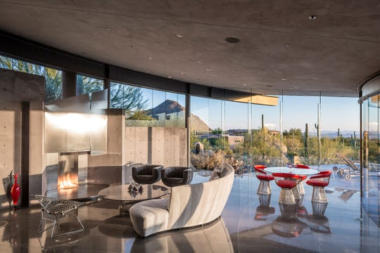 The $2.4M estate, sold by James Tracy O'Rourke, III, features floor-to-ceiling glass walls and limestone flooring.