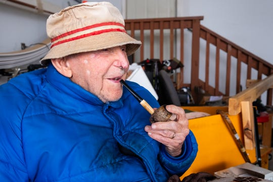 Luthard Eid, 103, sits in a chair in the garage of his Port Huron home, smoking his pipe, Thursday, Feb. 27, 2020. Even though Eid will turn 104 on Saturday, because his birthday is on Leap Day, he has only had 26 of them in his lifetime.