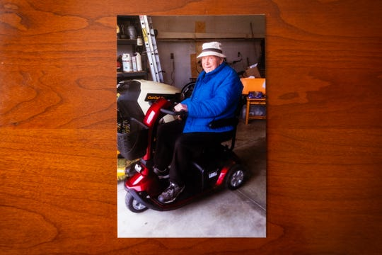 A photograph from Fall 2019 shows Luthard Eid, 103, on the scooter he rides around his neighborhood.