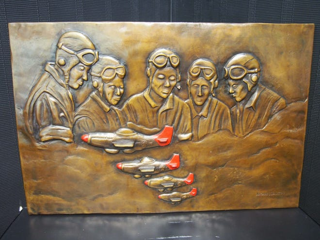 A bronze relief featuring Tuskegee Airmen and aircraft will be the centerpiece of a memorial planned for the Blue Water River Walk.
