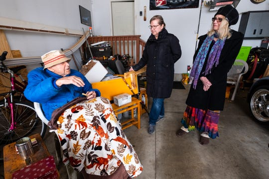 Sisters Marion Dietz, center, and Pauline Cameron, right, talk to their father, Luthard Eid, in the garage of his Port Huron home Thursday, Feb. 27, 2020.