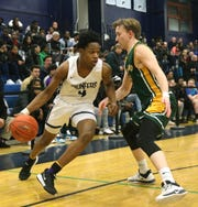 Poughkeepsie's Zaccai Curtis drives to the net through Lakeland's Jack Kruse during Wednesday's sectional quarterfinal on February 26, 2020.