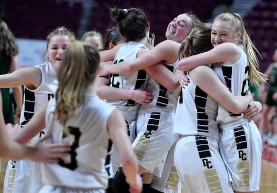 The Delone Catholic Squiretts celebrate after defeating Trinity 44-22 in the District 3 Class 3-A girls's basketball final, Thursday, February 27, 2020.