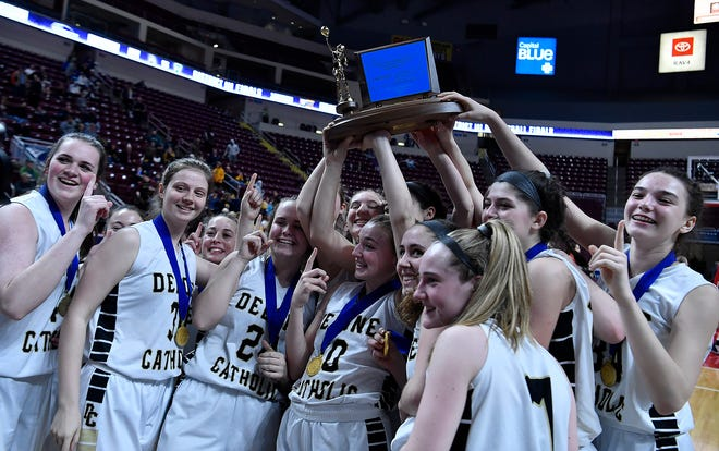 The Delone Catholic Squiretts celebrate after defeating Trinity 44-22 in the District 3 Class 3-A girls' basketball final on Thursday, Feb. 27, 2020. Unless the school wins a final appeal, the Squirettes will have to play in Class 4-A next season. John A. Pavoncello photo