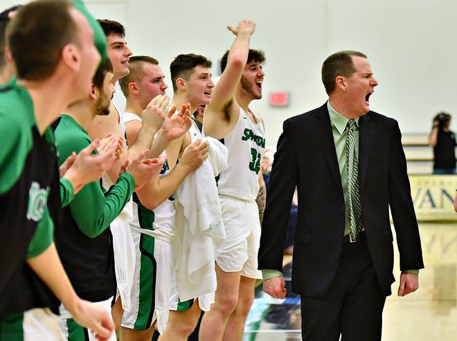 York College men's basketball head coach Matt Hunter and his team are shown last February. Hunter led the Spartans to a 23-6 record and a Capital Athletic Conference title. The Spartans, who are now in their first season in the Middle Atlantic Conference, won't play any men's basketball games before mid-February of 2021, at the earliest, because of the coronavirus pandemic. The MAC made that decision on Wednesday.