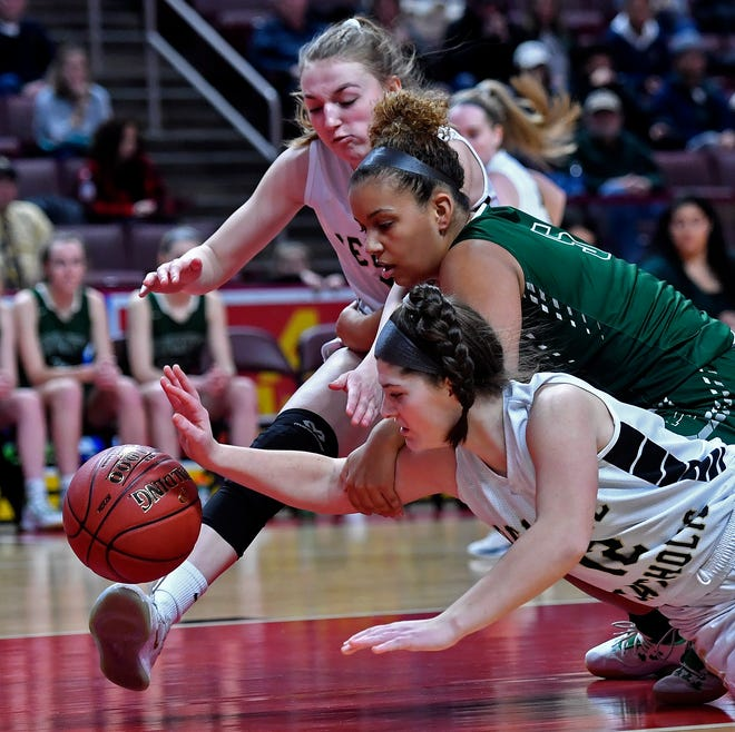Delone Catholic's Giana Hoddinott, bottom, is seen here in action against Trinity in last year's District 3 Class 3-A title game. Hoddinott scored 27 points on Thursday night in a regular-season win over the Shamrocks.