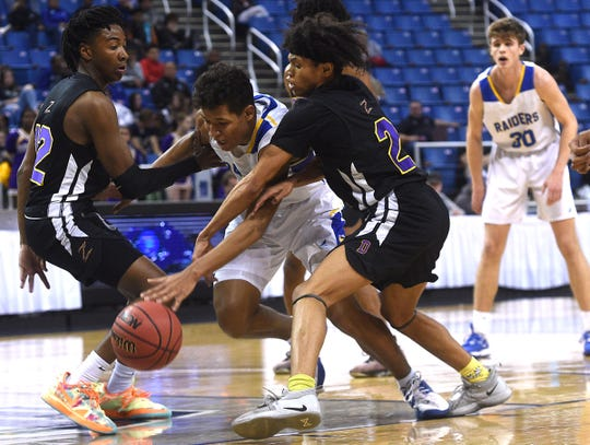 Reed's Marcus Thorne tries to navigate through traffic while taking on Durango during their NIAA quarterfinal game at Lawlor Events Center in Reno on Feb. 26, 2020.