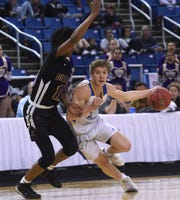 Reed's Ridge Peterson drives around a defender while taking on Durango during their NIAA quarterinal game at Lawlor Events Center in Reno on Feb. 26, 2020.