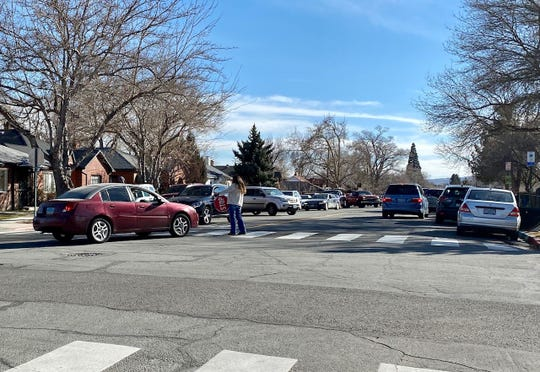A car comes dangerously close to hitting pedestrians in a crosswalk outside of Mt. Rose Elementary School on a recent afternoon.