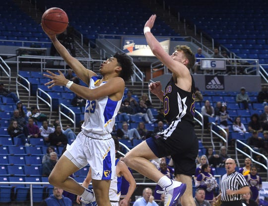 Reed's Michael Agee drives to the basket while taking on Durango during their NIAA quarterfinal game at Lawlor Events Center in Reno on Feb. 26, 2020.