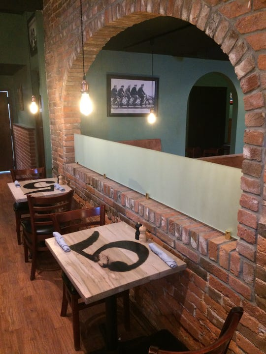 The number 5 and brick arches figure heavily in the decor inside 5 Arch Brewing at 129 E. Main St. in Centerville.