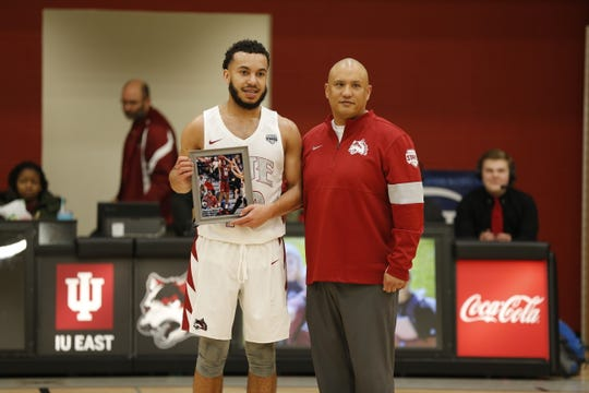 Bishop Smith and head coach Mark Hester pose as Smith broke IU East's men's all-time scoring record on Wednesday, Feb. 26, 2020.