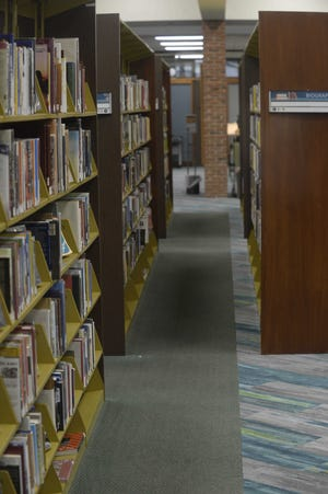 Morrisson-Reeves Library has reopened so that patrons may browse the book shelves and check out materials.