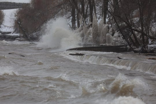Waves crash onto the Lake Ontario shoreline at Webster Park on Feb. 27, 2020.