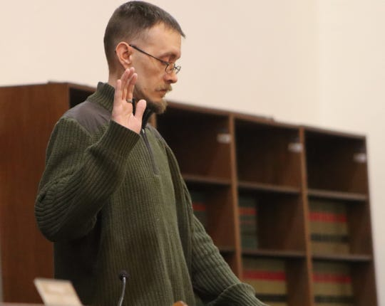 Jason DeShane takes an oath before testifying Feb. 26, 2020 in Oneida County Supreme Court in Rome. DeShane said a statement he gave to police in November, used to uphold a seizure of his father's firearms, had inaccuracies.