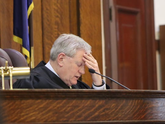 State Supreme Court Judge Patrick MacRae reviews a police report before ruling an order to seize Michael DeShane's firearms would be continued for another year on Wednesday, Feb. 26, 2020 in Oneida County Supreme Court in Rome.