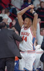 Syracuse's John Wallace celebrates his team's win over Georgia in their NCAA West Regional semifinal game in Denver, Friday, March 22, 1996. Syracuse won 83-81 in overtime.