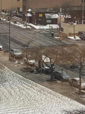 A white van is inspected by a bomb squad robot near the Rochester federal building Thursday.