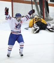 Fairport's Caleb Kaiser celebrates the games lone goal by teammate Travis Knicley in a win over McQuaid to move on to the Class A final